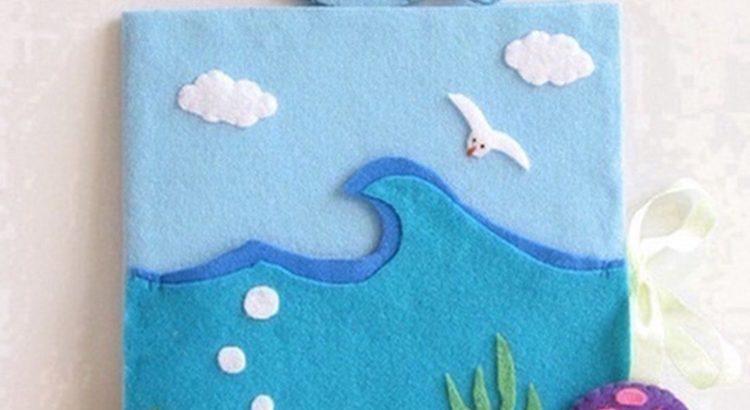 libro forrado con tela representando el mar